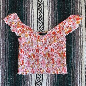 70s inspired floral crop top with ruffles